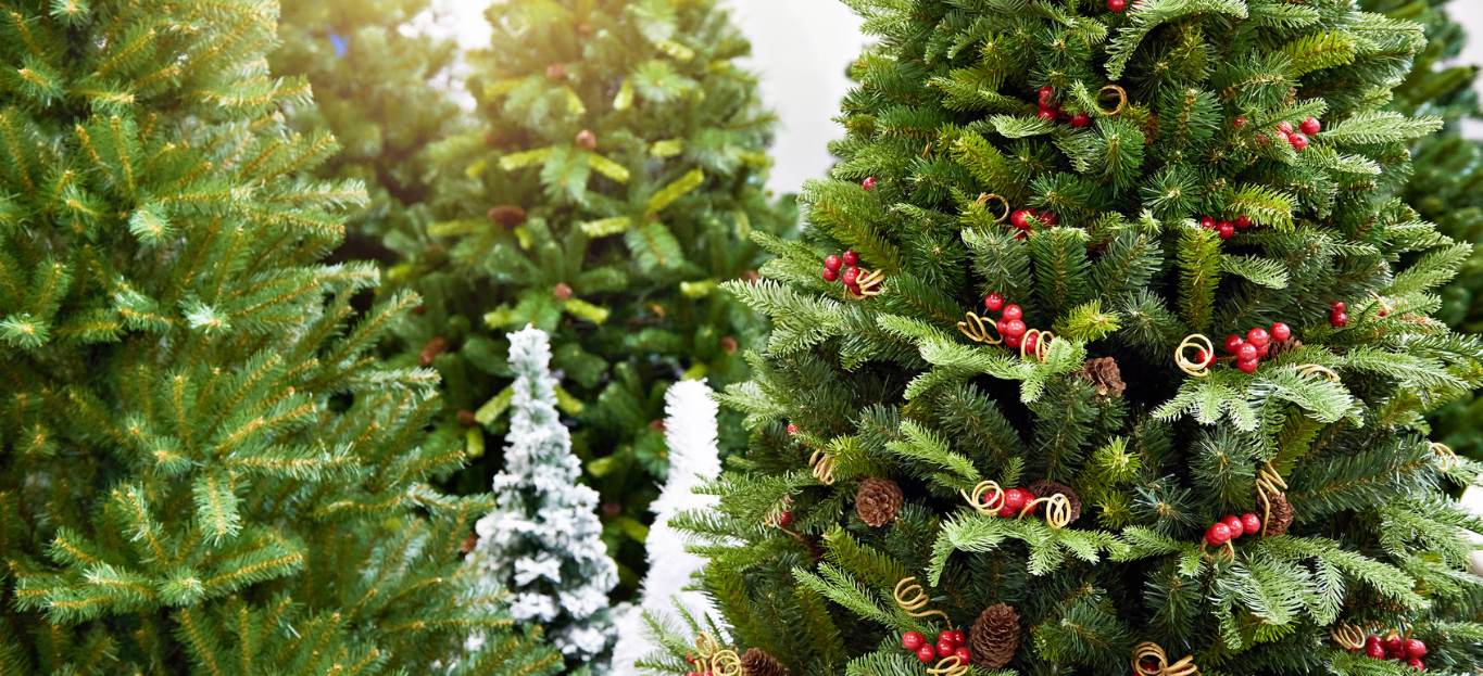 Decorative artificial christmas trees in the store